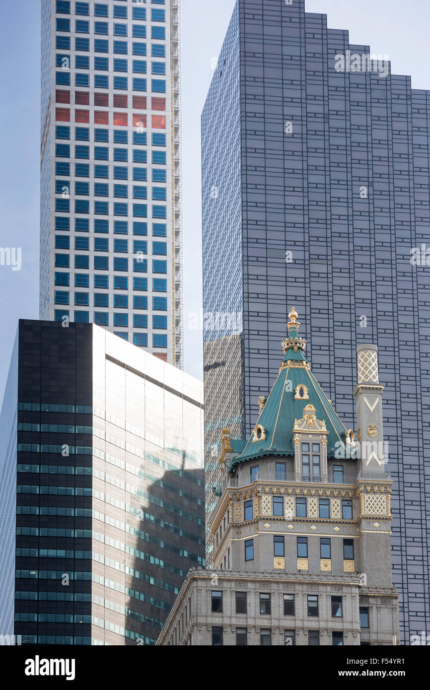 High rise skyscrapers in glass and gold leaf on corner of 57th Street and 6th Avenue, Avenue of the Americas, New - Stock Image