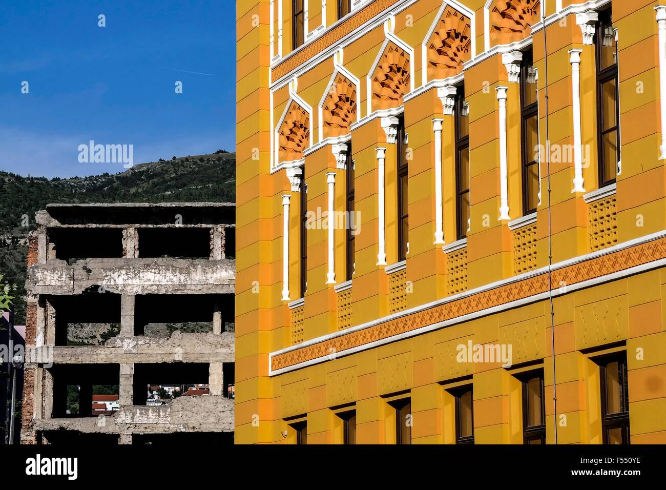 Building of the United World College and ruin in Mostar. - Stock Image
