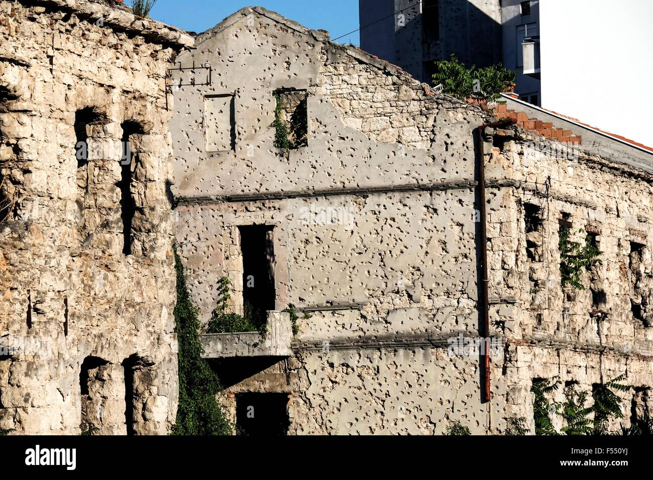 House dotted with bulletholes in Mostar. - Stock Image