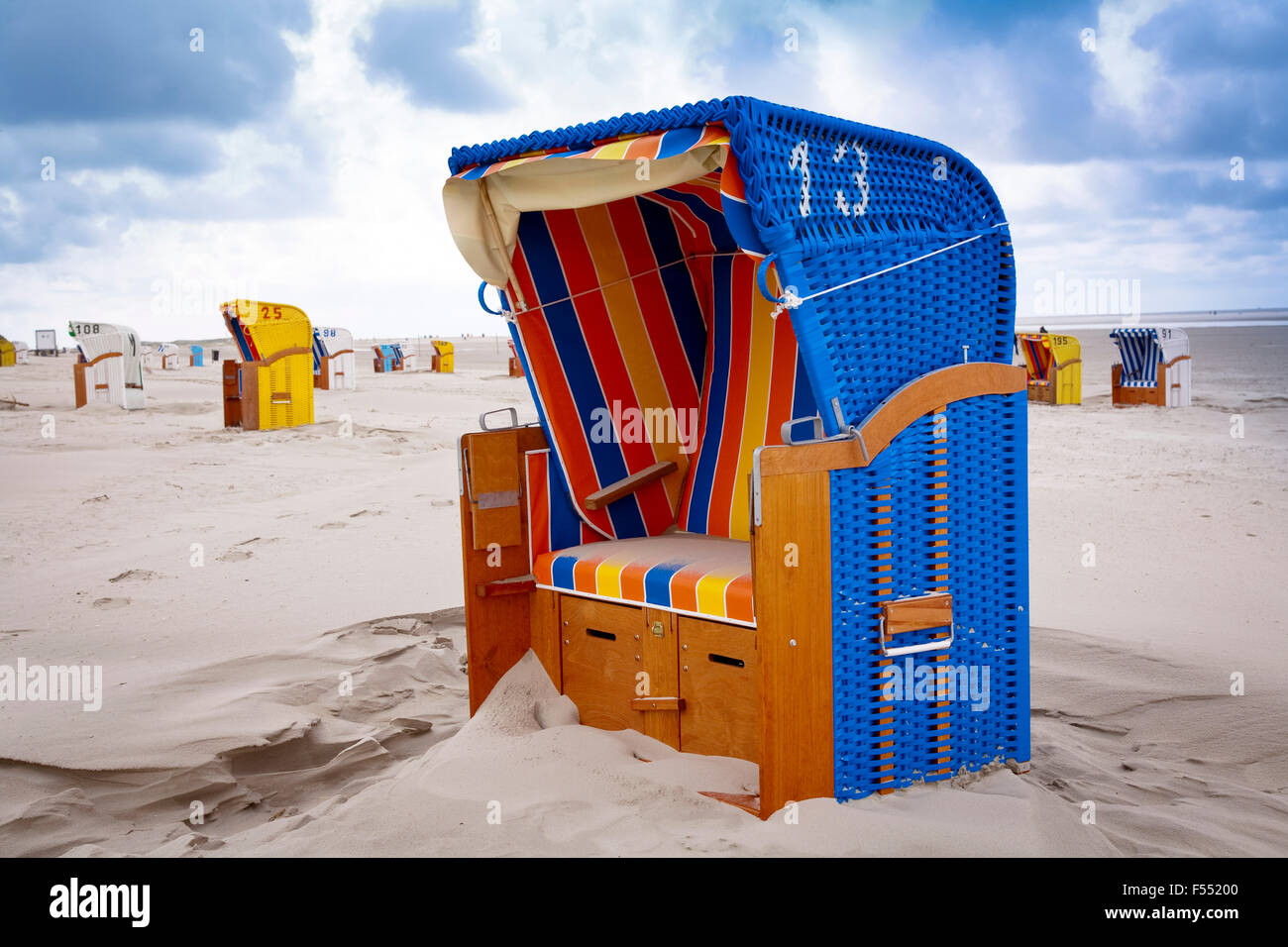 DEU, Germany, Schleswig-Holstein, North Sea,  Amrum island, beach chairs at the beach Kniepsand near Norddorf.  - Stock Image