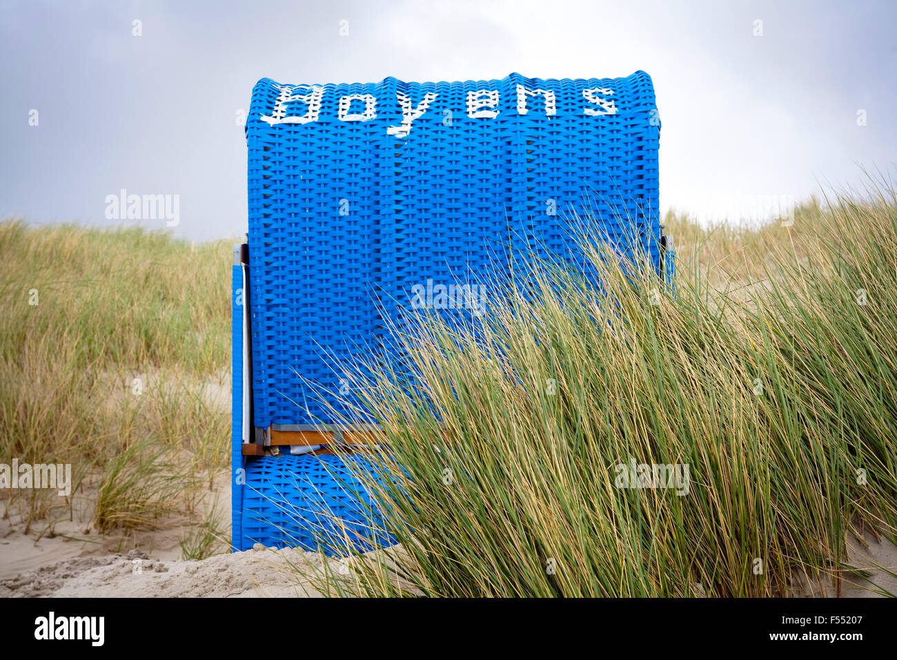 DEU, Germany, Schleswig-Holstein, North Sea,  Amrum island, beach chair in the dunes at the beach Kniepsand near - Stock Image