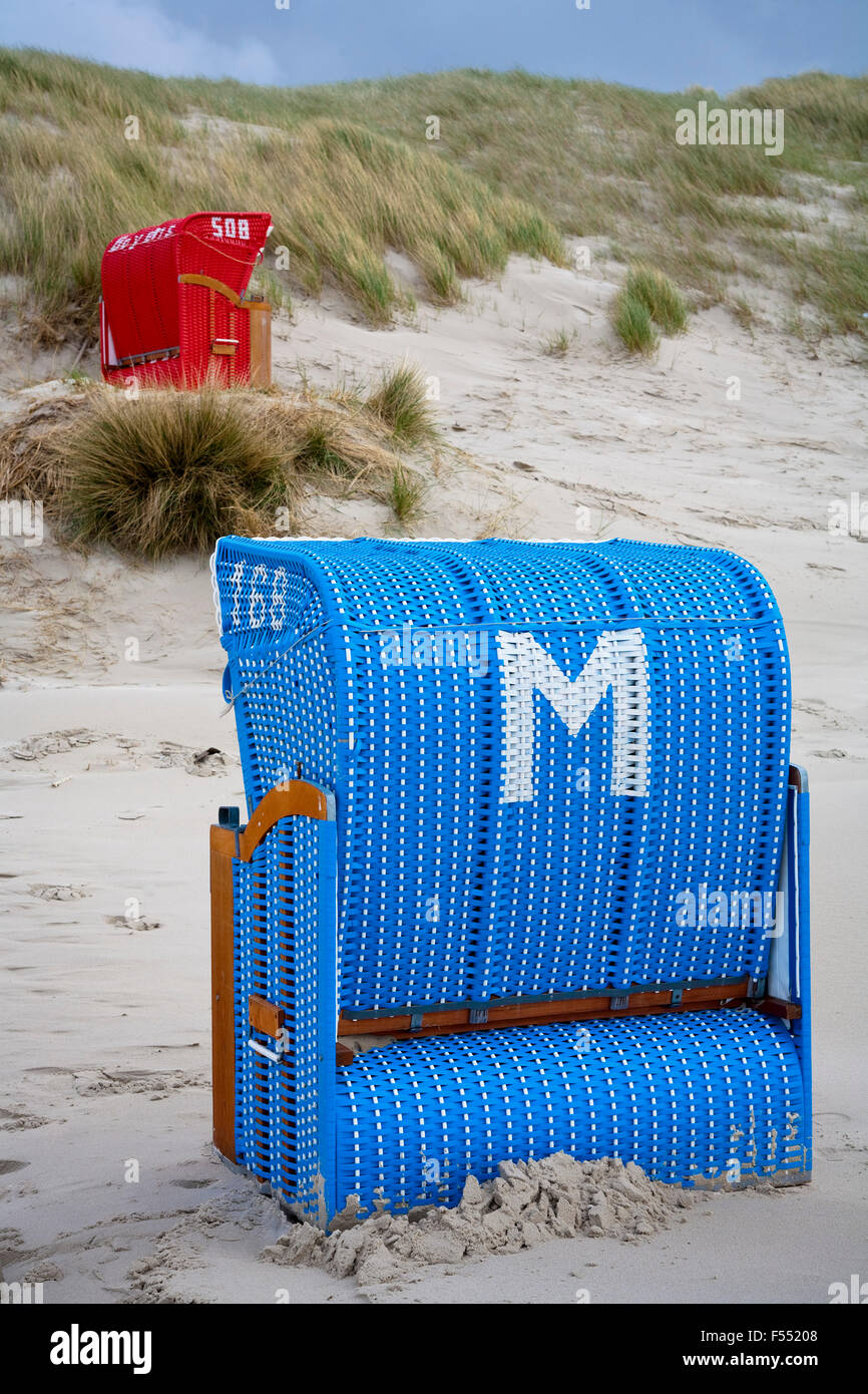 DEU, Germany, Schleswig-Holstein, North Sea,  Amrum island, beach chairs in the dunes at the beach Kniepsand near - Stock Image