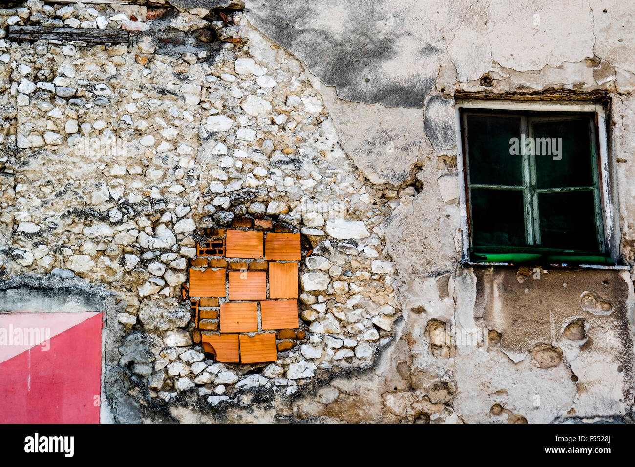 Repaired damage from Bosnian Civil War in a house in Mostar. - Stock Image