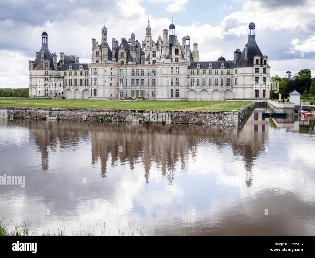 Chambord and its Canal Reflection. The huge Chateau of Chambord including its reflection in the canal at the rear. - Stock Image