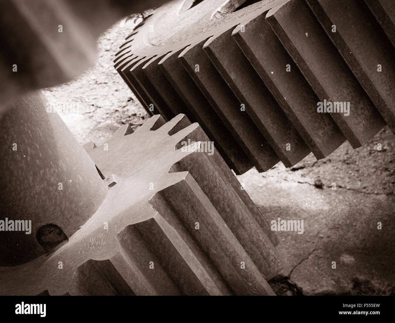 Meshing Gears - monochrome. Two large gears from a repurposed sugar cane plant rust away. Sugar Mill, Haleiwa, Hawai'i, - Stock Image