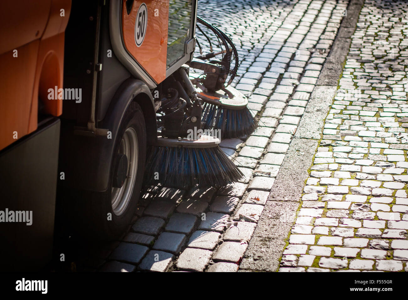 Street sweeper cleaning the streets Stock Photo