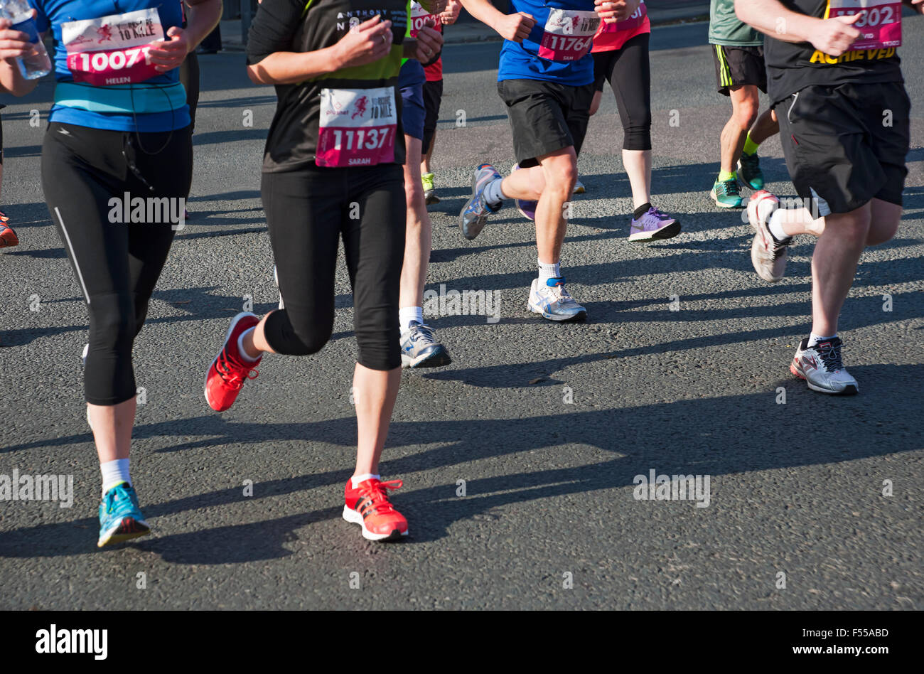 Legs of runners in 10 mile race York North Yorkshire England UK United Kingdom GB Great Britain - Stock Image