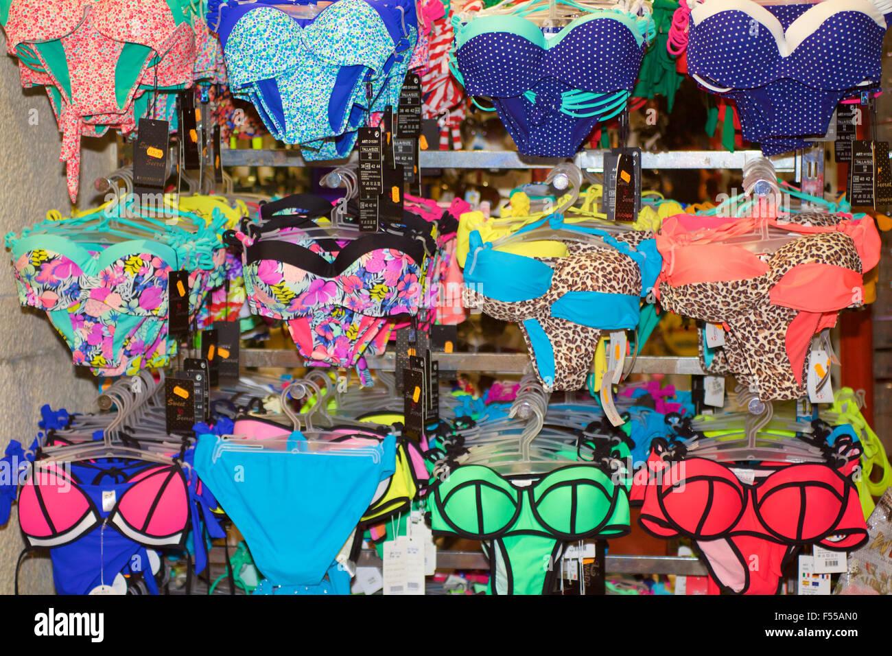 A shop display of brightly coloured bikini swimwear. - Stock Image