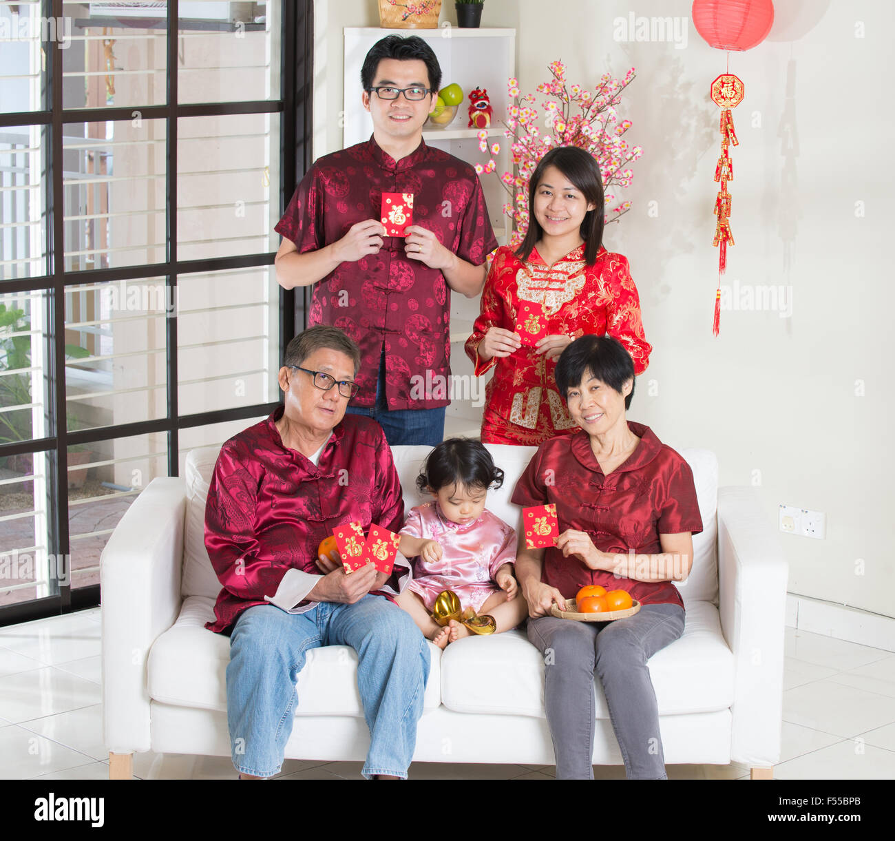 asian family with chinese new year greetings