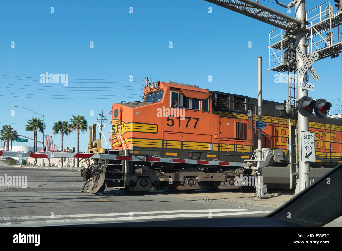 Diesel Electric locomotive crossing a level crossing in Long Beach California USA - Stock Image