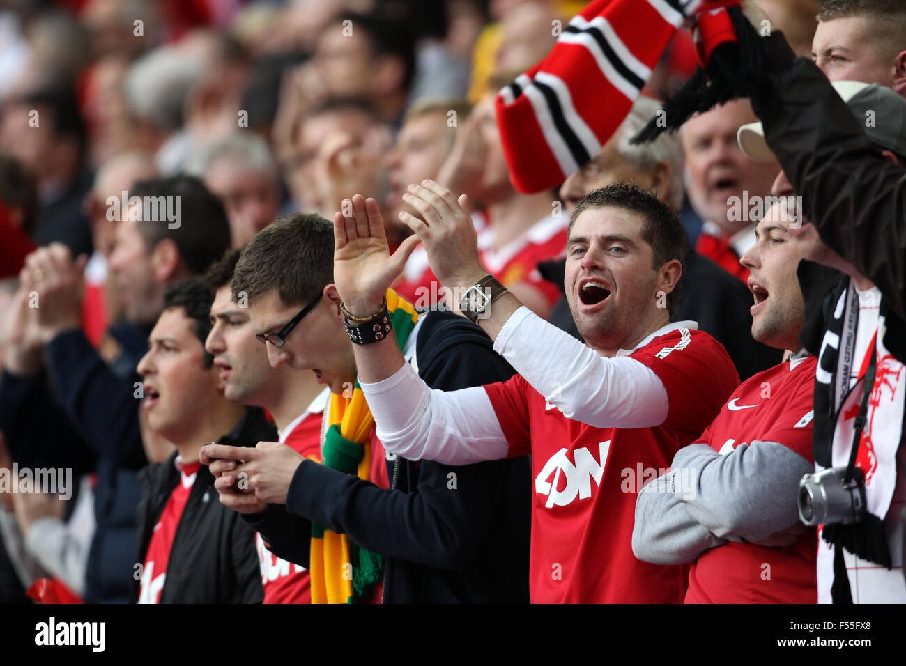 English football fans are seen at Wembley Stadium in 2013 Stock Photo
