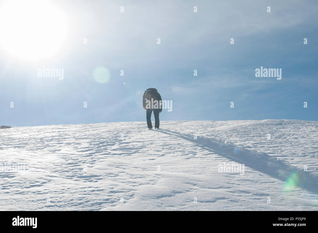 Man walking up a mountain in winter Faraya Kesrwan Lebanon - Stock Image