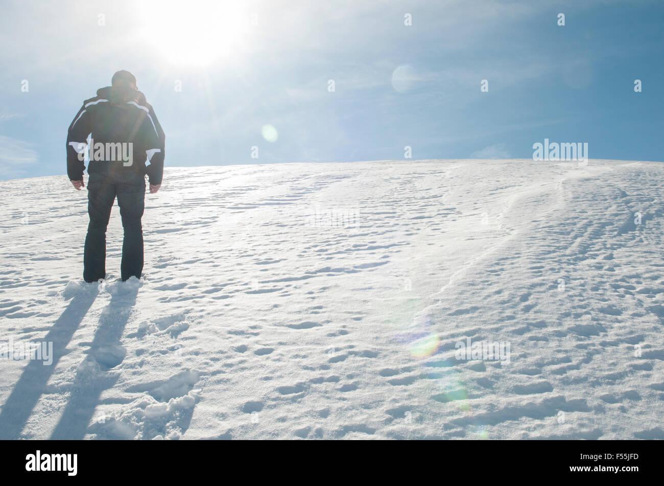 Man walking up a mountain covered with snow Faraya Kesrwan Lebanon Middle East - Stock Image