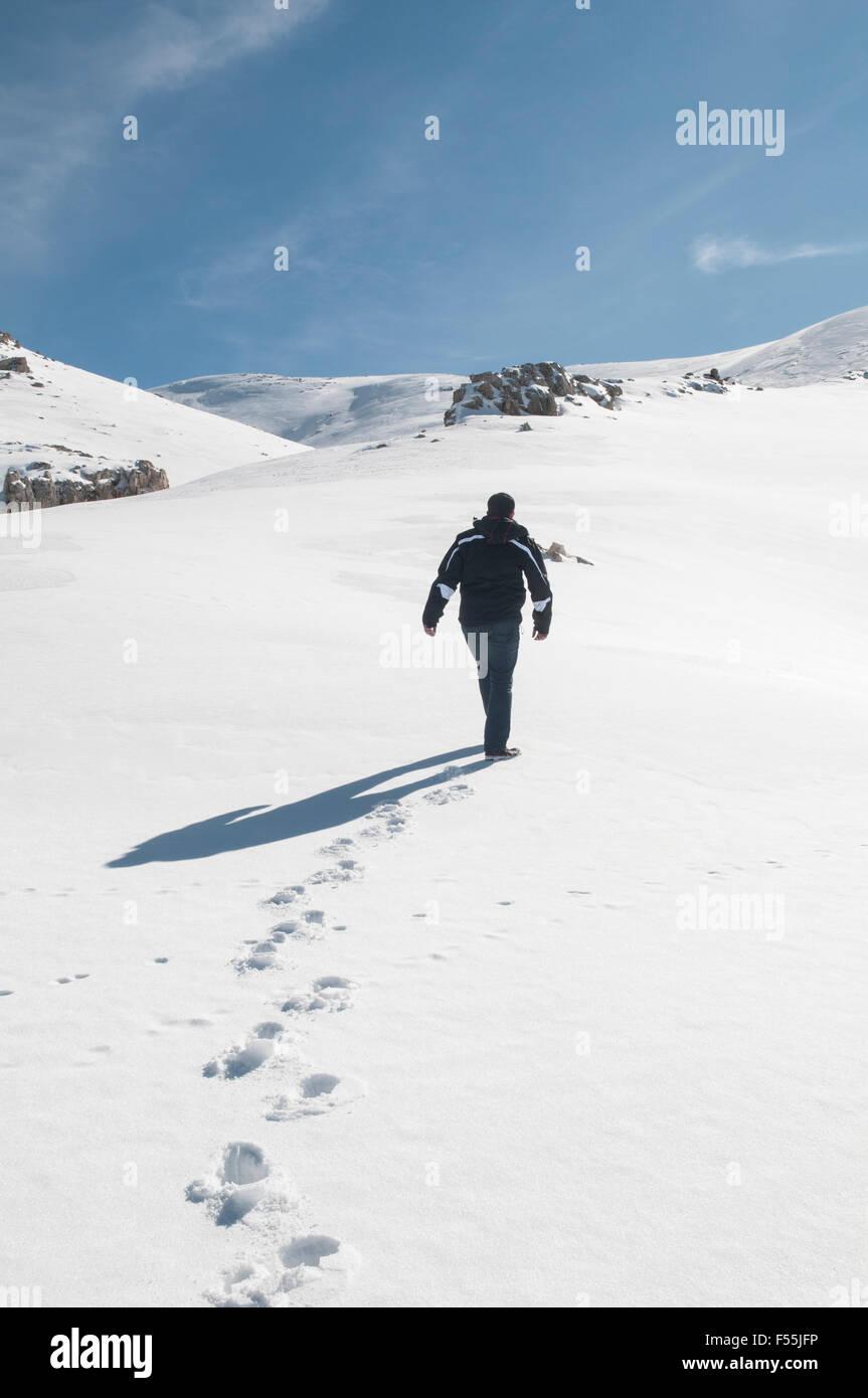 Man walking on the snow Faraya Kesrwan Lebanon Middle East - Stock Image