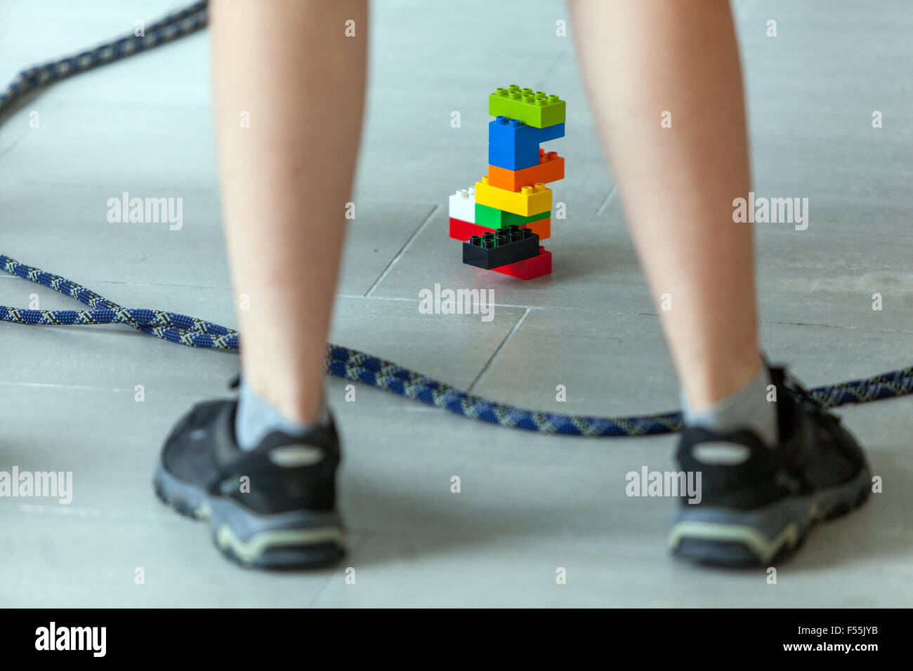 Lego bricks, Plastic cubes in the hands of a child's game that develops creativity and imagination Stock Photo