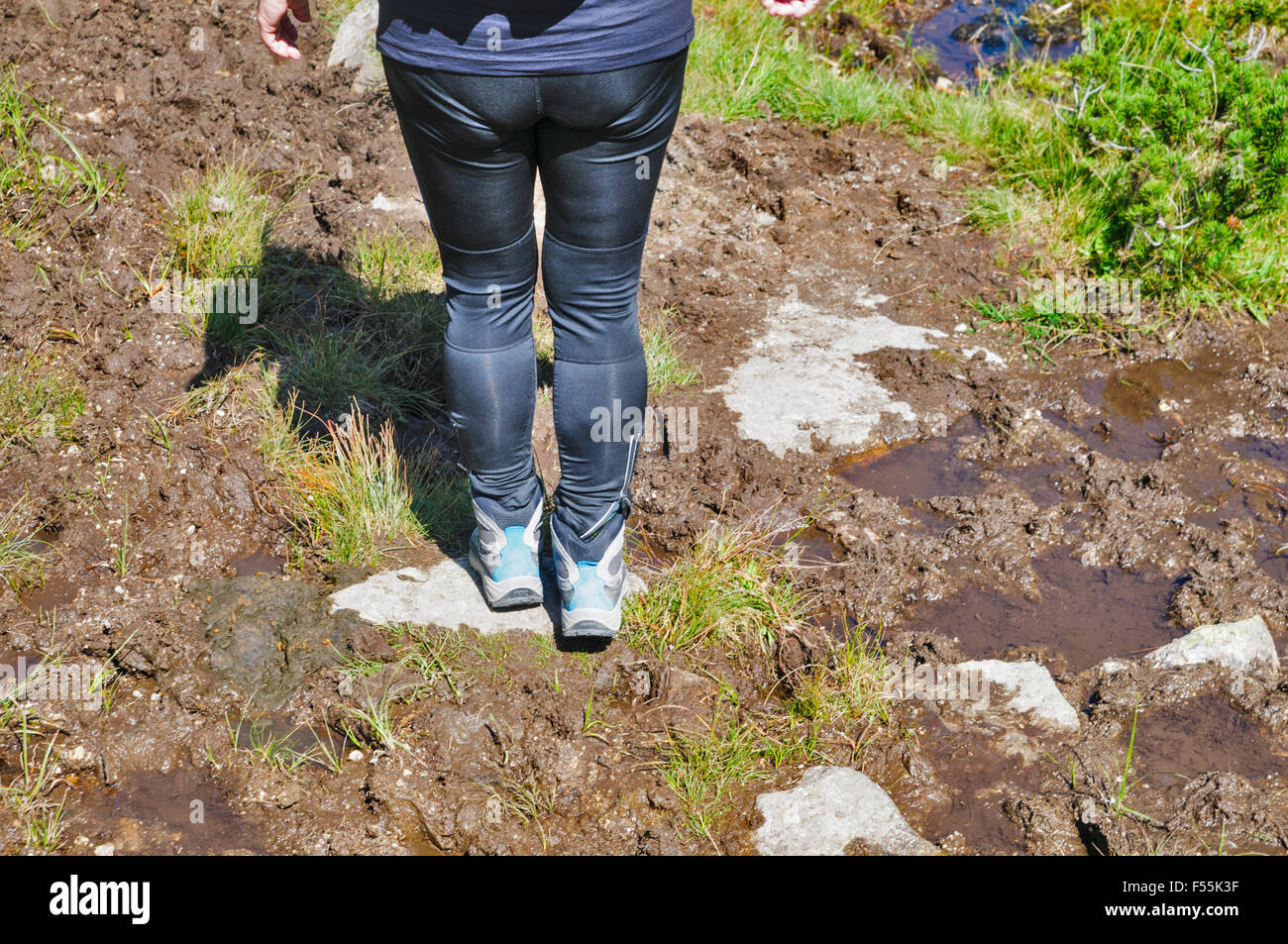 Female hiker in Zillertal alps, Tirol, Austria. Close up of the legs and boots Model release available Stock Photo