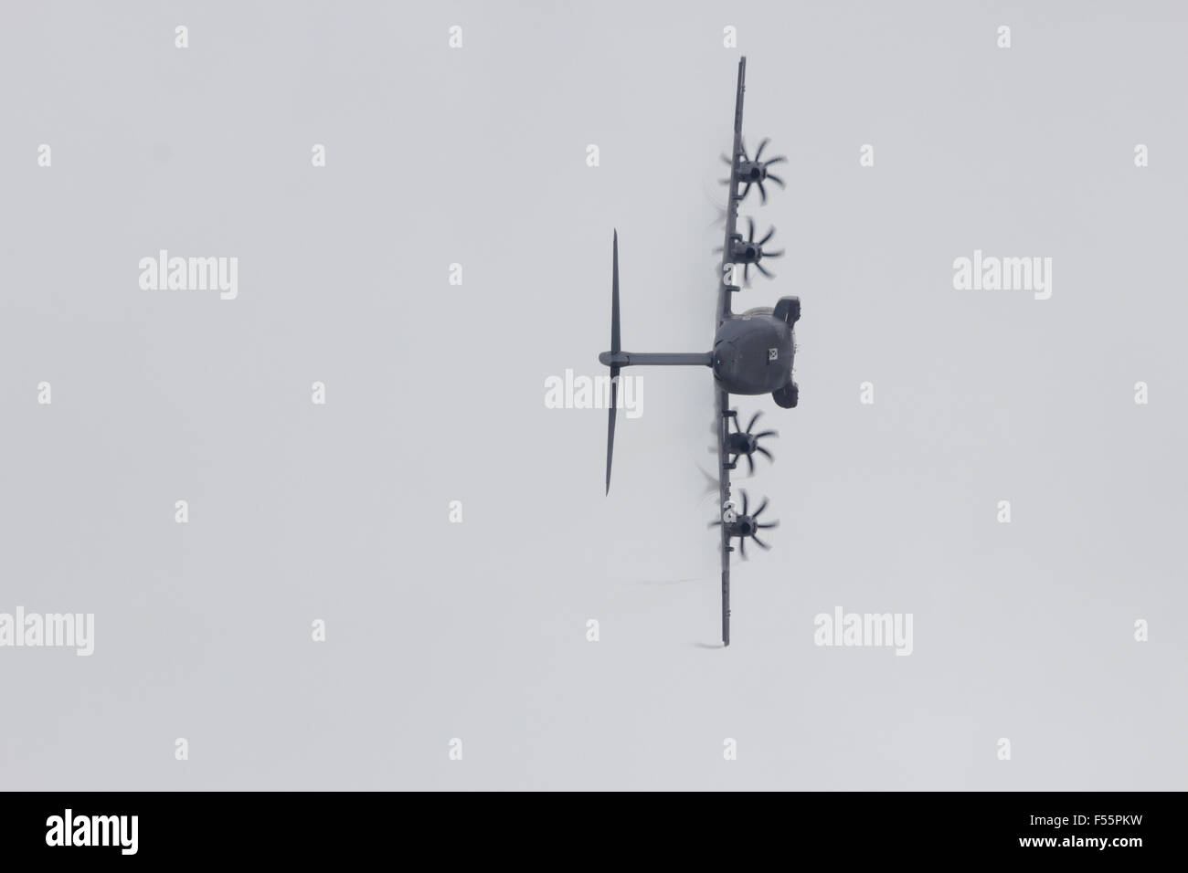 Airbus A400M military transport plane in a sharp turn. The first A400M was delivered to the French Air - Stock Image