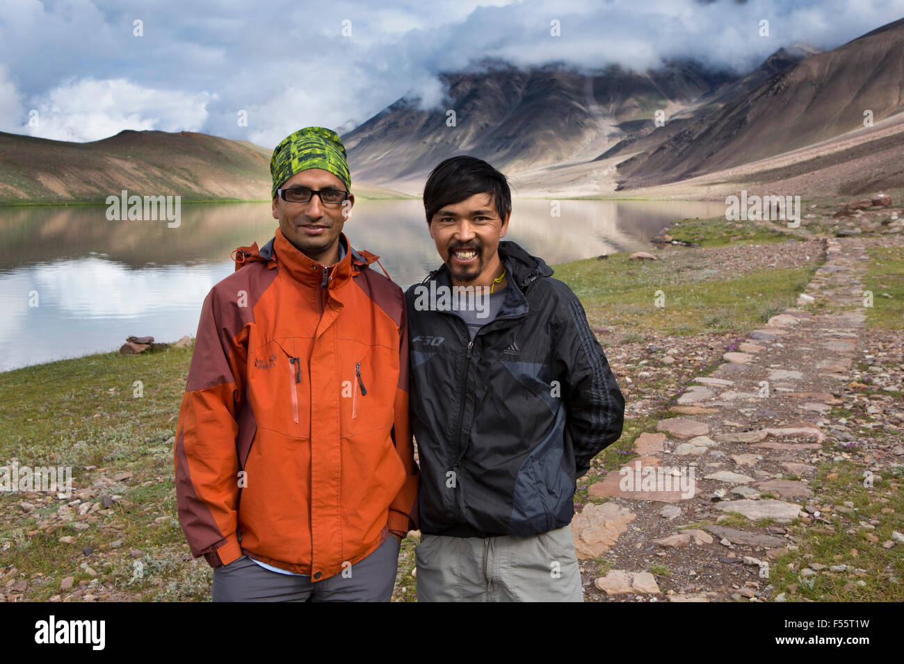 India, Himachal Pradesh, Spiti, Chandra Taal, Full Moon Lake, local driver & guide posing for early morning - Stock Image