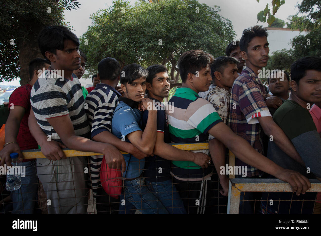 Obtaining asylum requires a long wait at the Police station. hundreds of refugees stand their numbers to be called - Stock Image