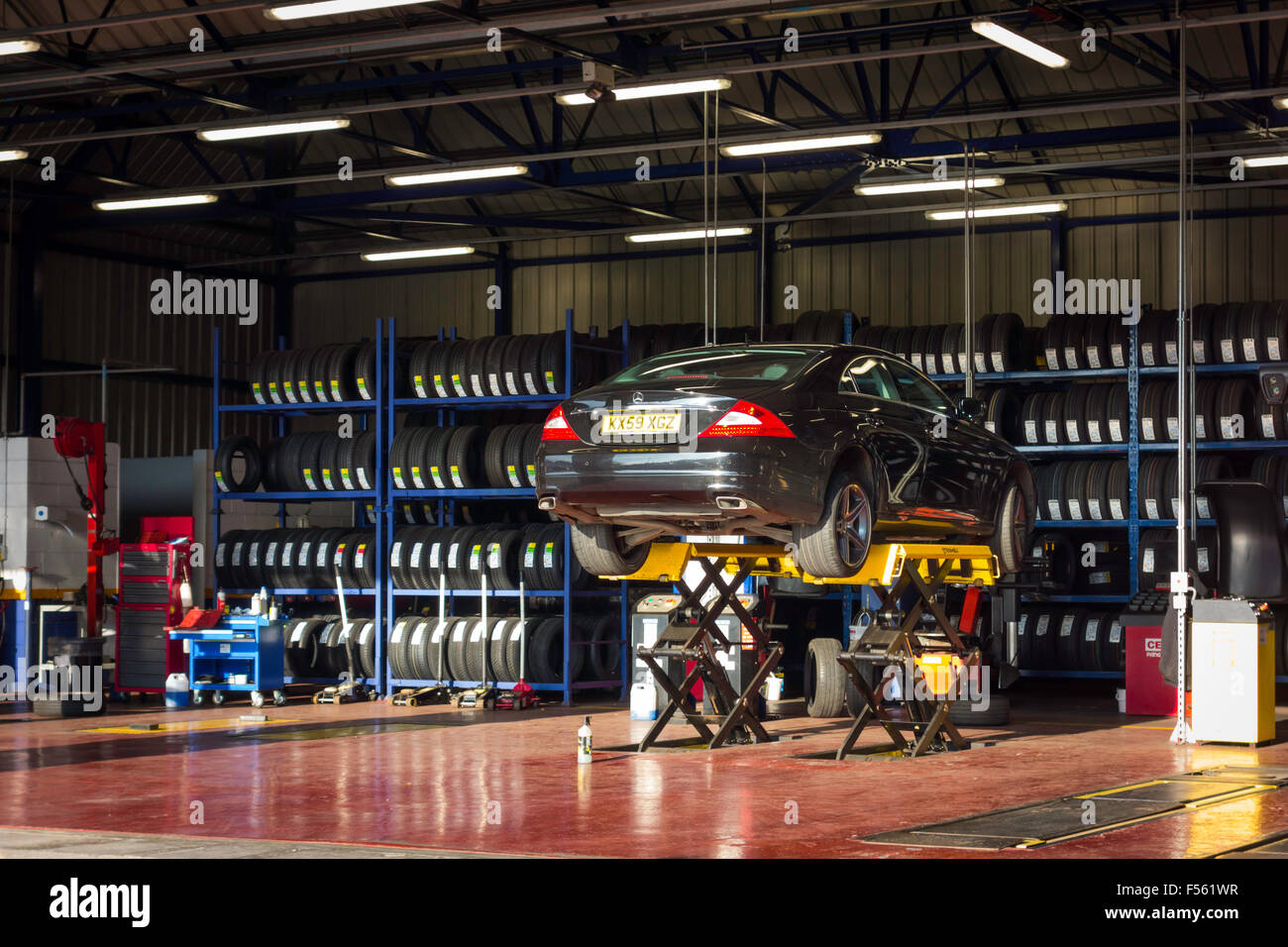 Kwik Fit motor vehicle tyre and exhaust repair and replacement facility - Stock Image