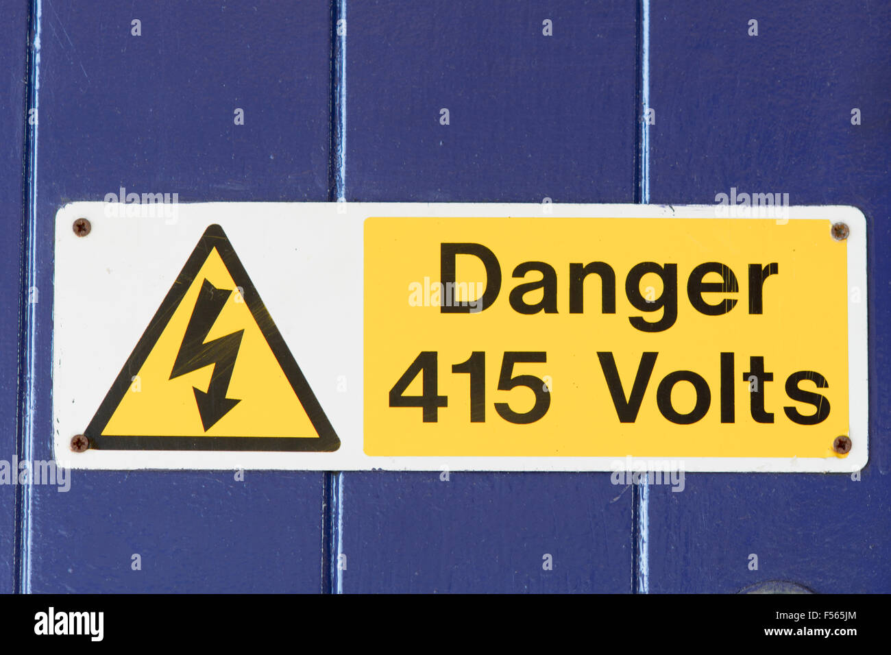 Danger 415 Volts Sign With Symbol On Wooden Door Stock Photo