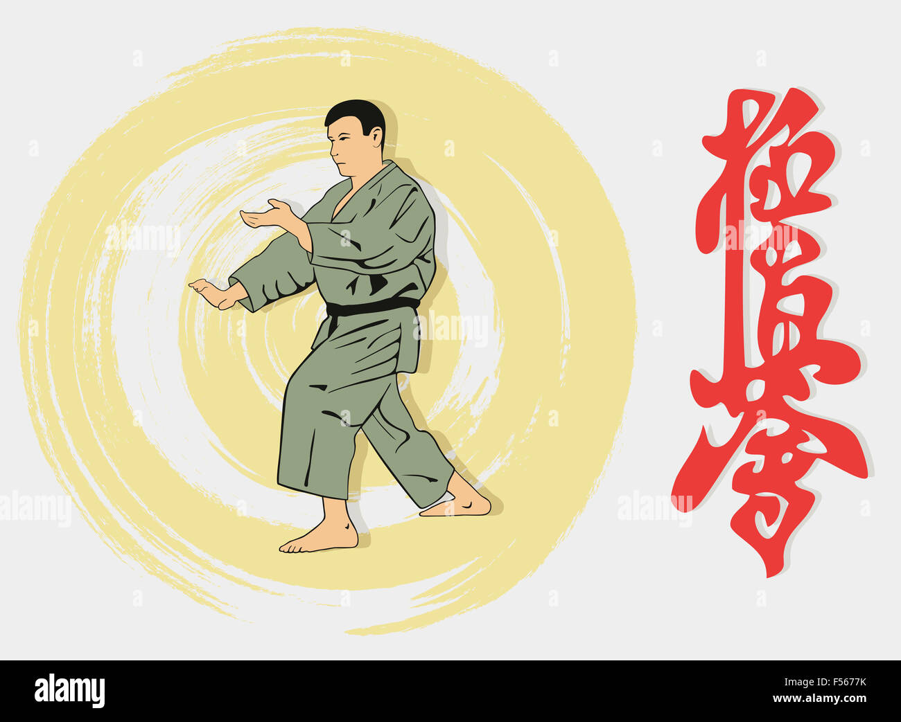 The man showing karate and a hieroglyph. - Stock Image