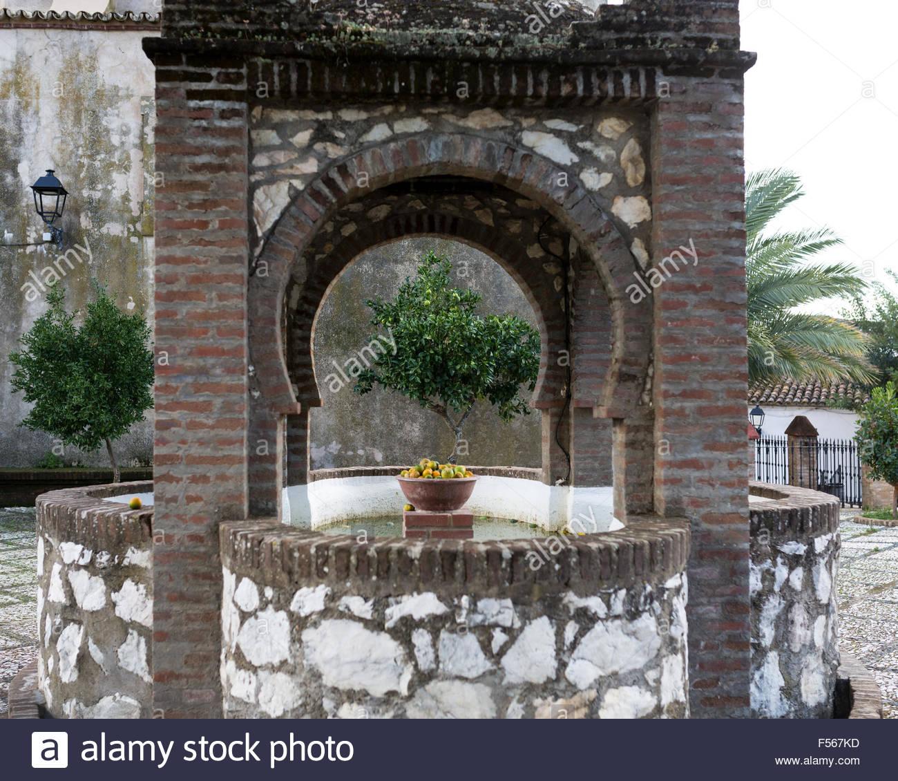 Water WellSan Juan Bautista Church courtyard in Linares, Sierra de Huelva, Andalusia Spain - Stock Image