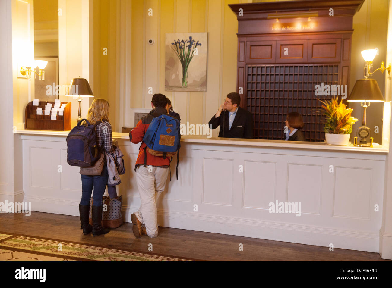 Guests at hotel reception, the luxury Mount Washington Hotel Resort, Bretton Woods, New Hampshire USA - Stock Image