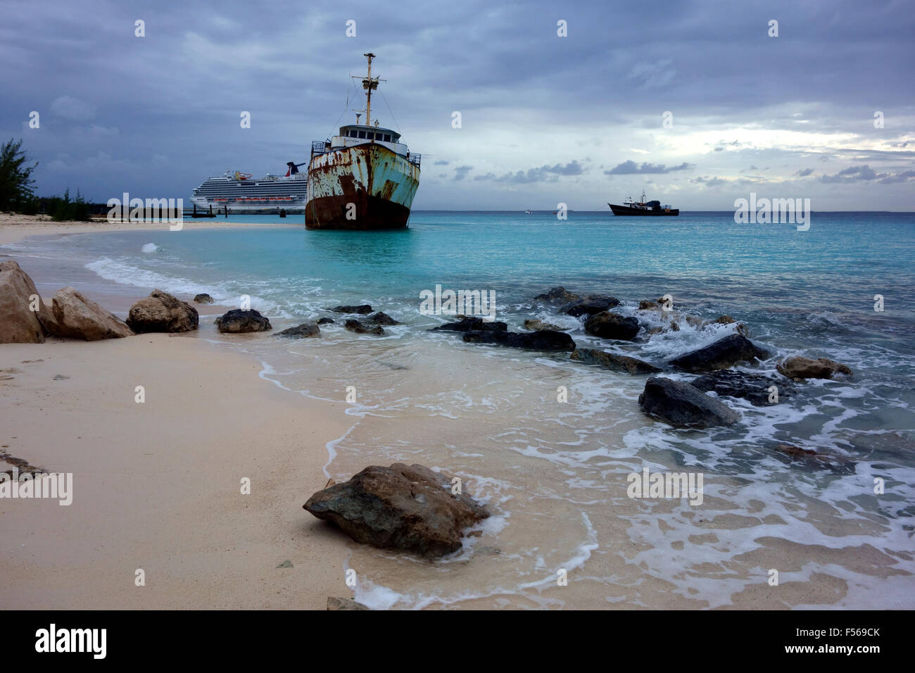 Grand Turk beach and a shipwreck in the dusk, Grand Turk, Turks  and Caicos, Caribbean - Stock Image