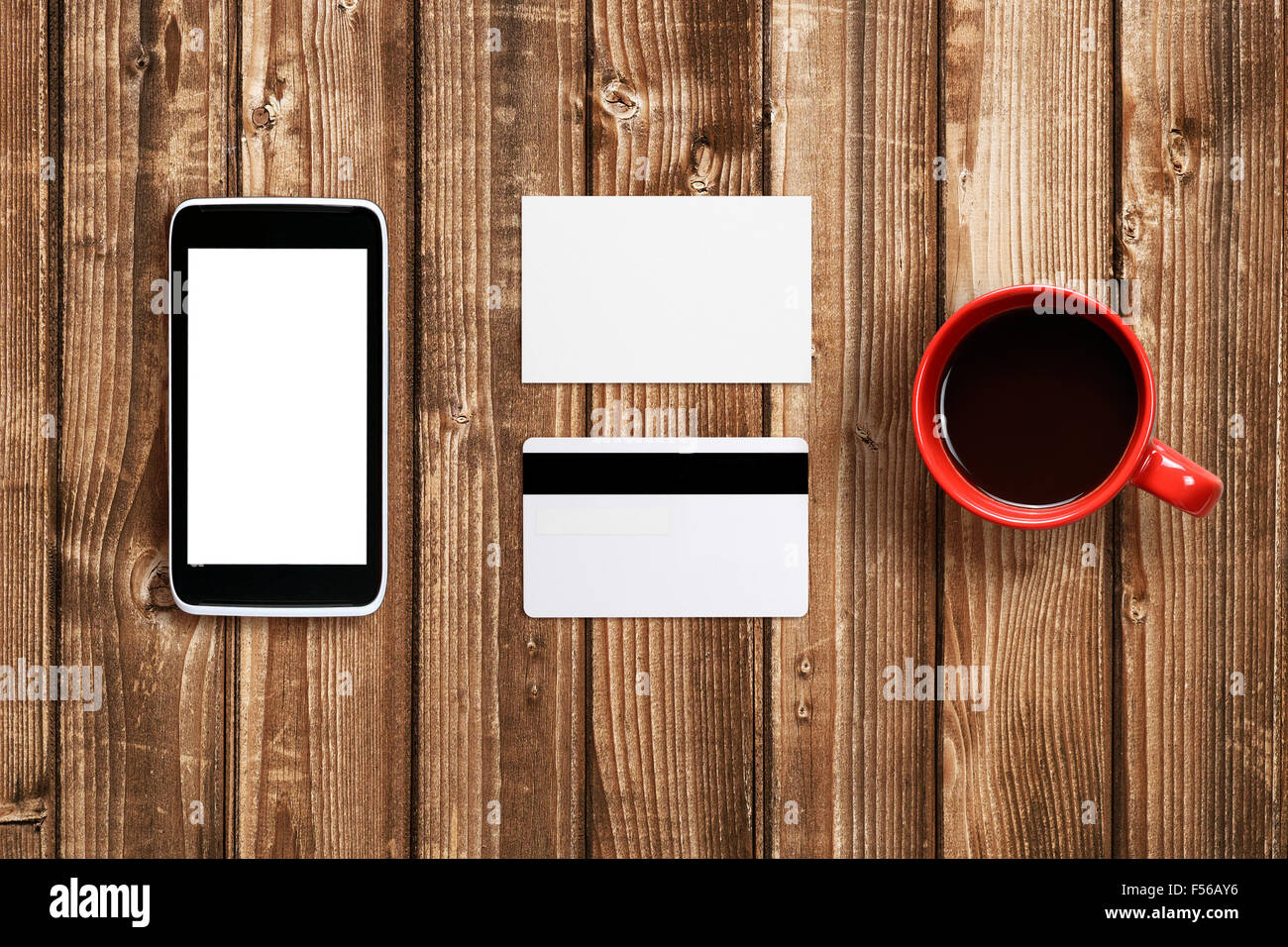 Business card, plastic card and cell phone mock-up on table Stock ...