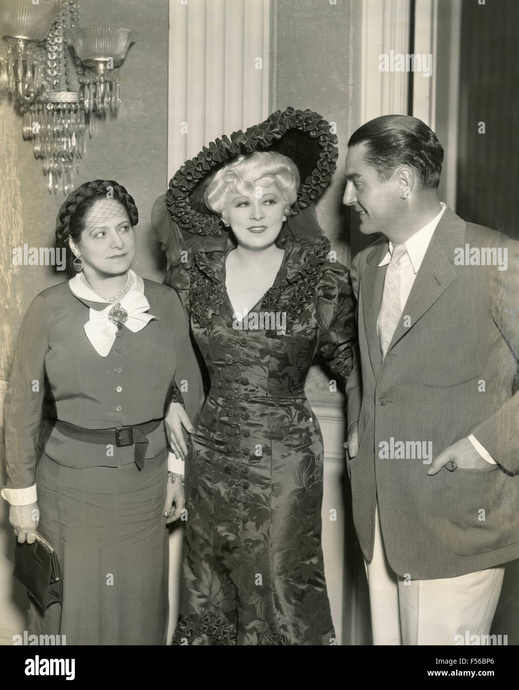 The American actress Mae West with director Leo McCarey and Madame Helena Rubinstein, USA - Stock Image
