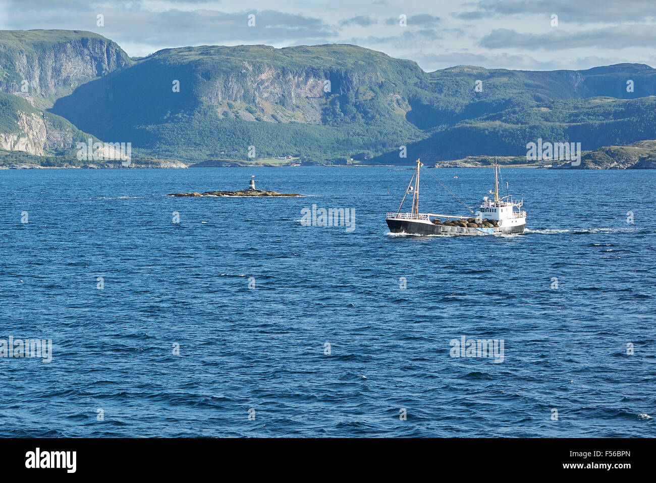 A Norwegian Coastal Vessel Sailing North, Far Above The Artic Circle. - Stock Image