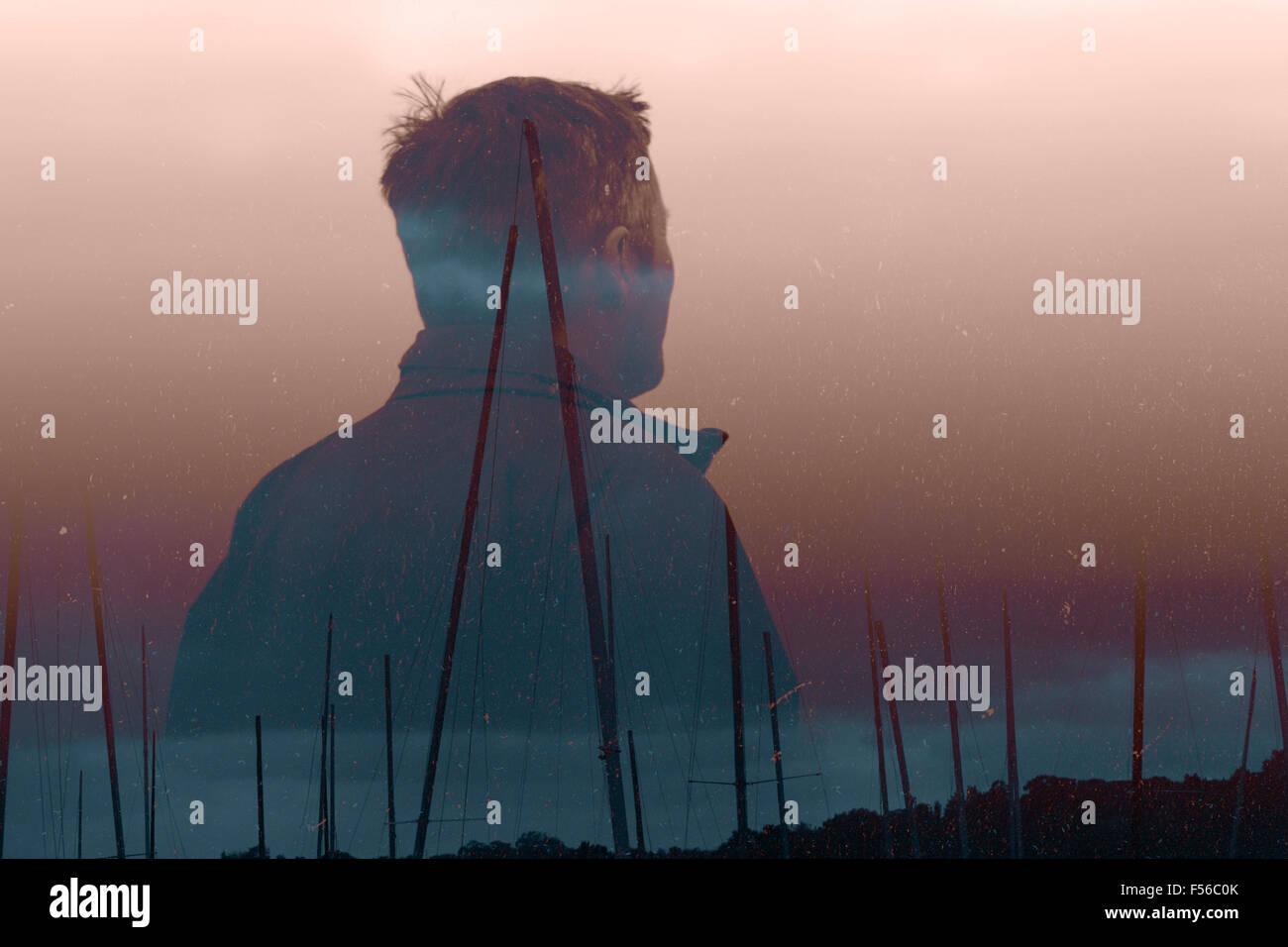 Fisherman double exposed with boasting masts - Stock Image