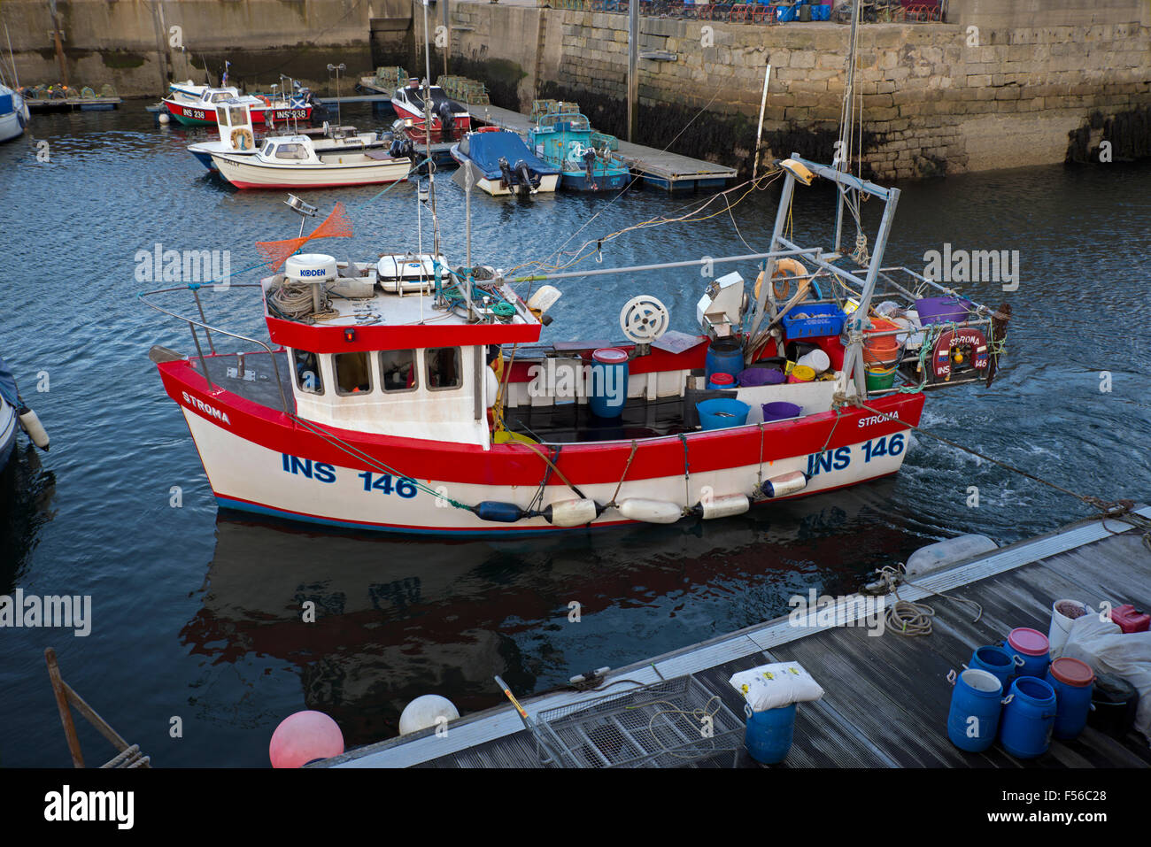 The fishing boat Stroma returning to Lossiemouth Harbour in Morayshire, Scotland, UK. - Stock Image