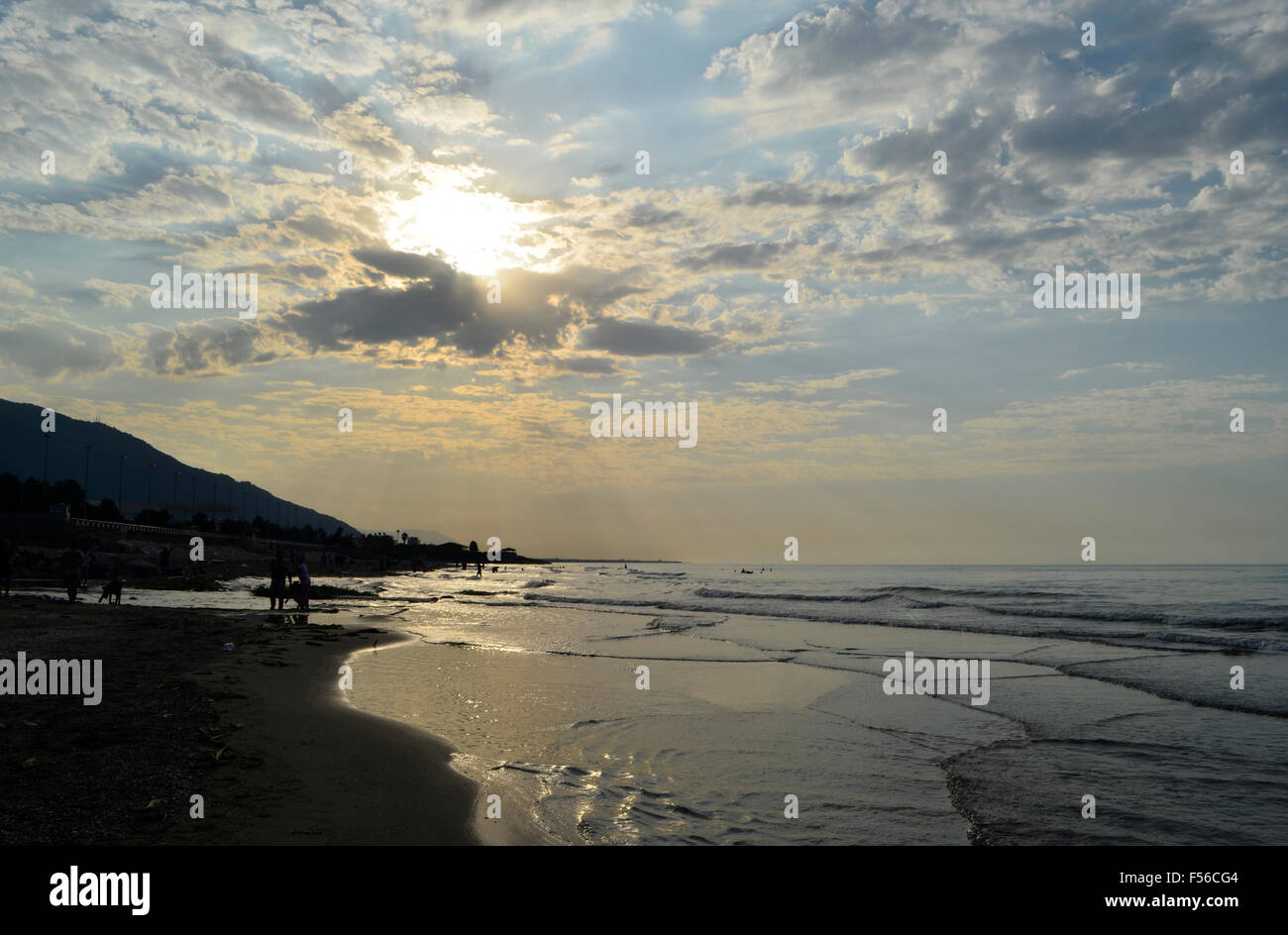 Sunshine on Caspian sea with clouds in the sky - Stock Image