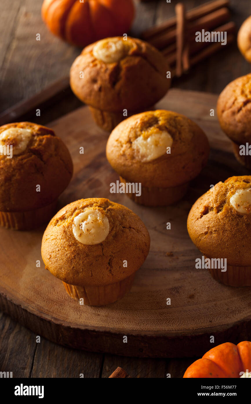 Homemade Pumpkin Spice Muffins with Cream Cheese Frosting - Stock Image