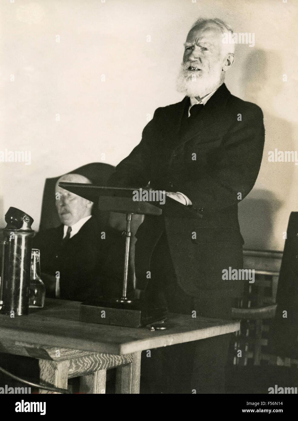 The Irish playwright George Bernard Shaw speaks to the British Academy, London, UK - Stock Image
