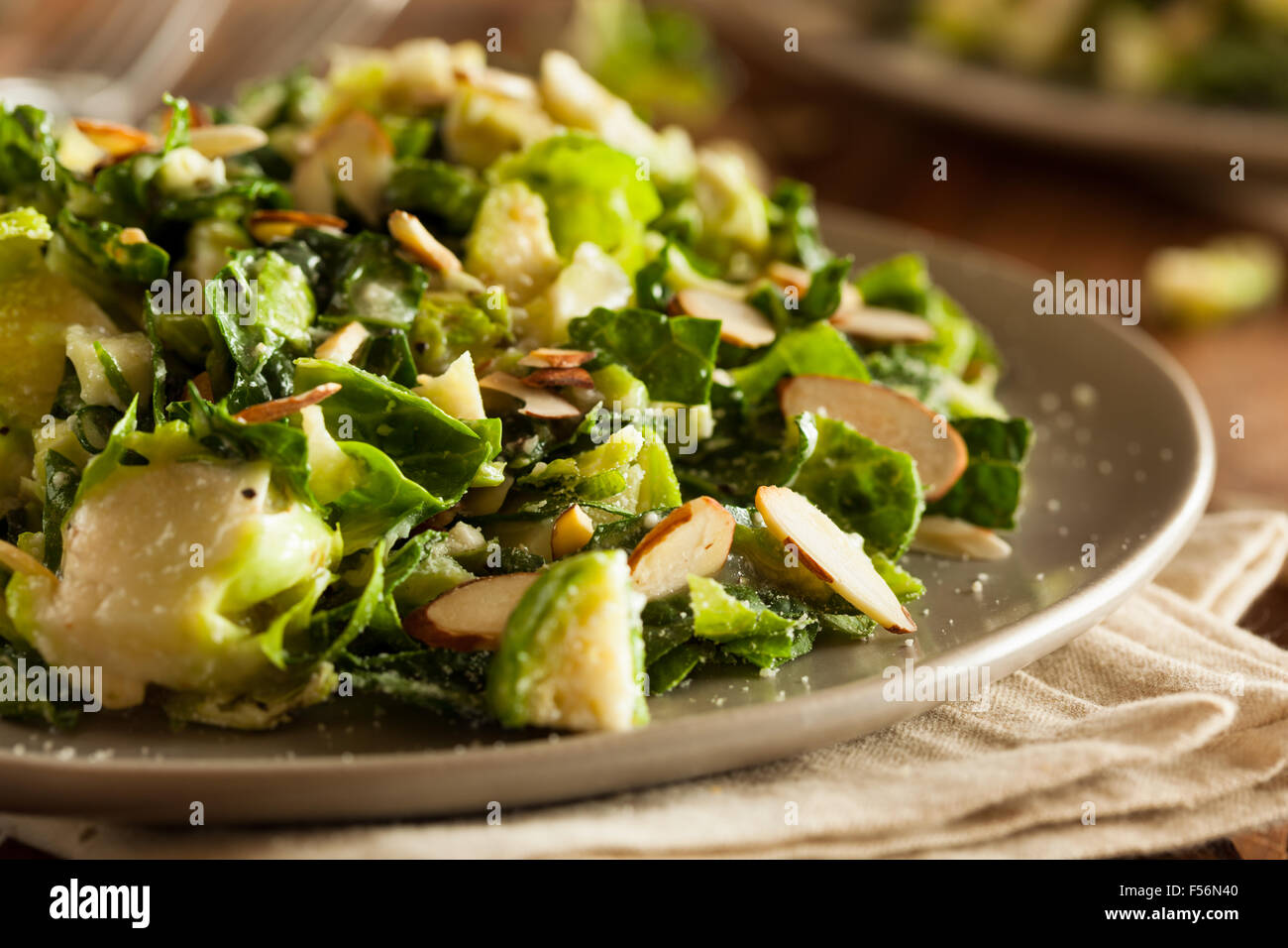 Kale and Brussel Sprout Salad with Almons and Lemon Dressing - Stock Image