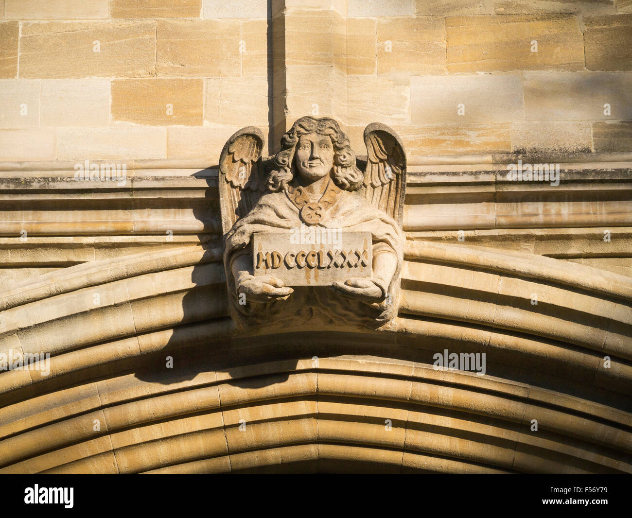 Stone carved angel above entrance to St John's College Oxford St Giles Oxford England UK - Stock Image
