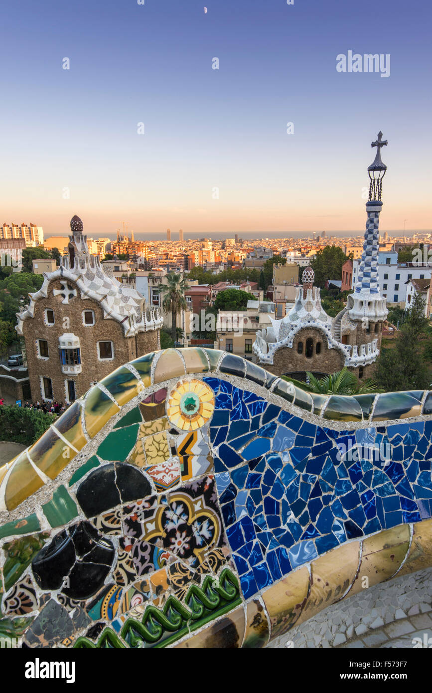 Park Guell with city skyline behind at sunset, Barcelona, Catalonia, Spain - Stock Image