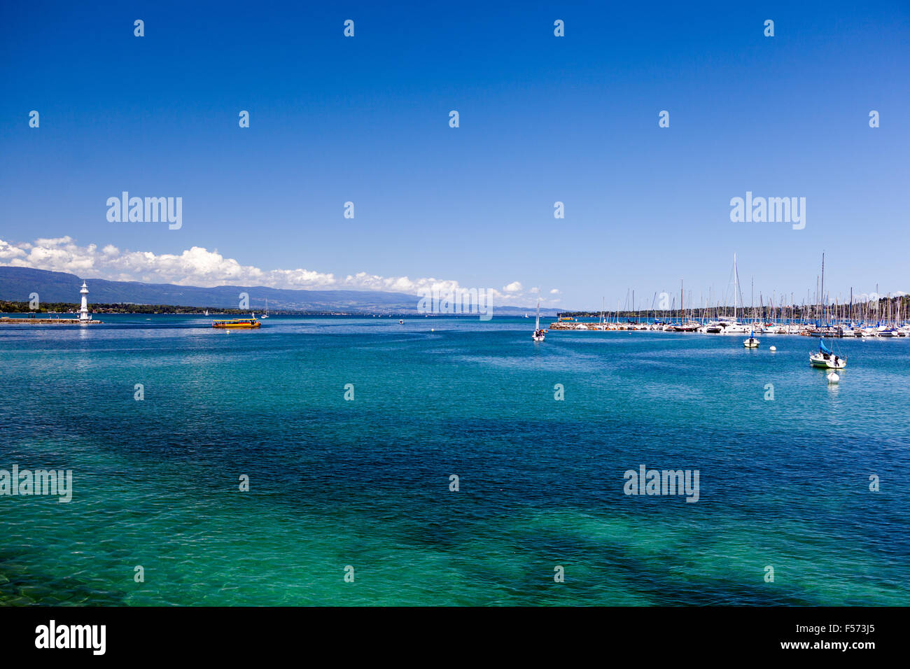 Turquoise-blue water, blue sky, pure mediterranean atmosphere at lake Geneva Lac Léman - Stock Image