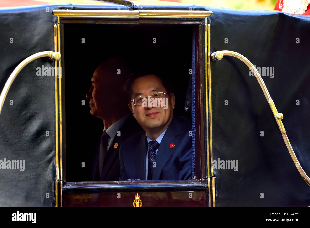 London Oct 20th. Chinese officials in a horse-drawn carriage in the Mall as Chinese President Xi Jinping starts - Stock Image