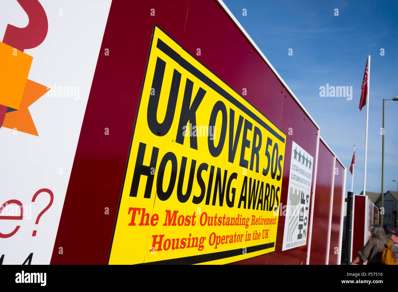 Billboard promoting UK over 50's Housing Awards on new development - Stock Image