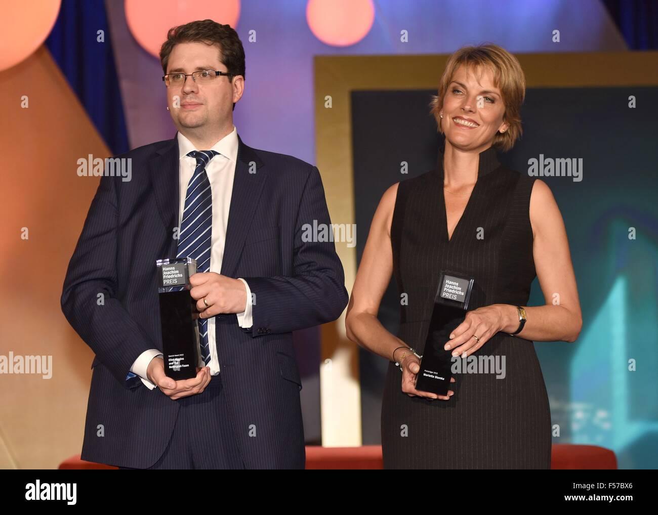 Cologne, Germany. 28th Oct, 2015. The award winners, British journalist Eliot Higgins and ZDF journalist Marietta Stock Photo