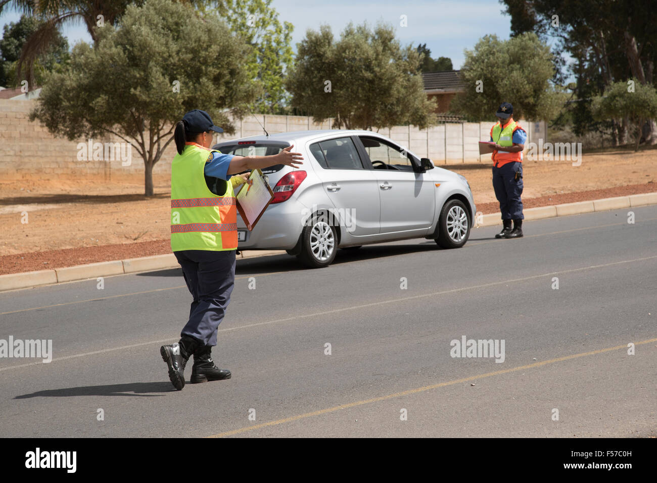 Traffic police taking driver details on roadside during a road block set up in Wellington Western Cape South Africa - Stock Image