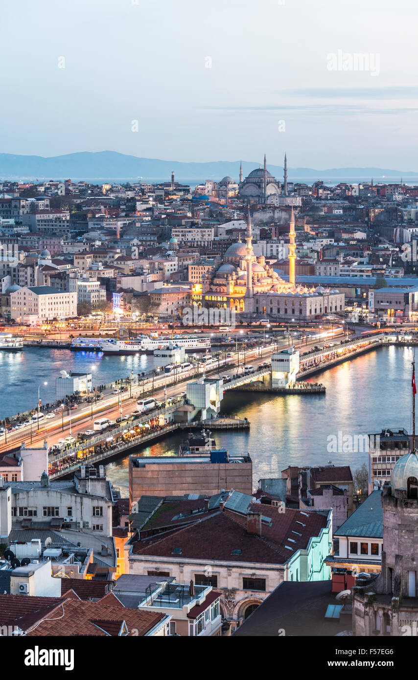 Cityscape at night, Galata Bridge, Golden Horn, Bosphorus, New Mosque, Mosque, Fatih, Istanbul, European side, Turkey - Stock Image