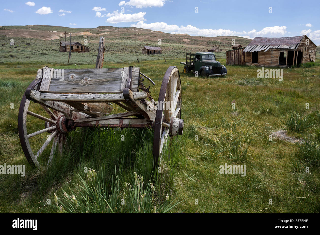Old wooden cart, vintage car built in the 30s, old wooden houses, ghost town, old gold mining town, Bodie State - Stock Image