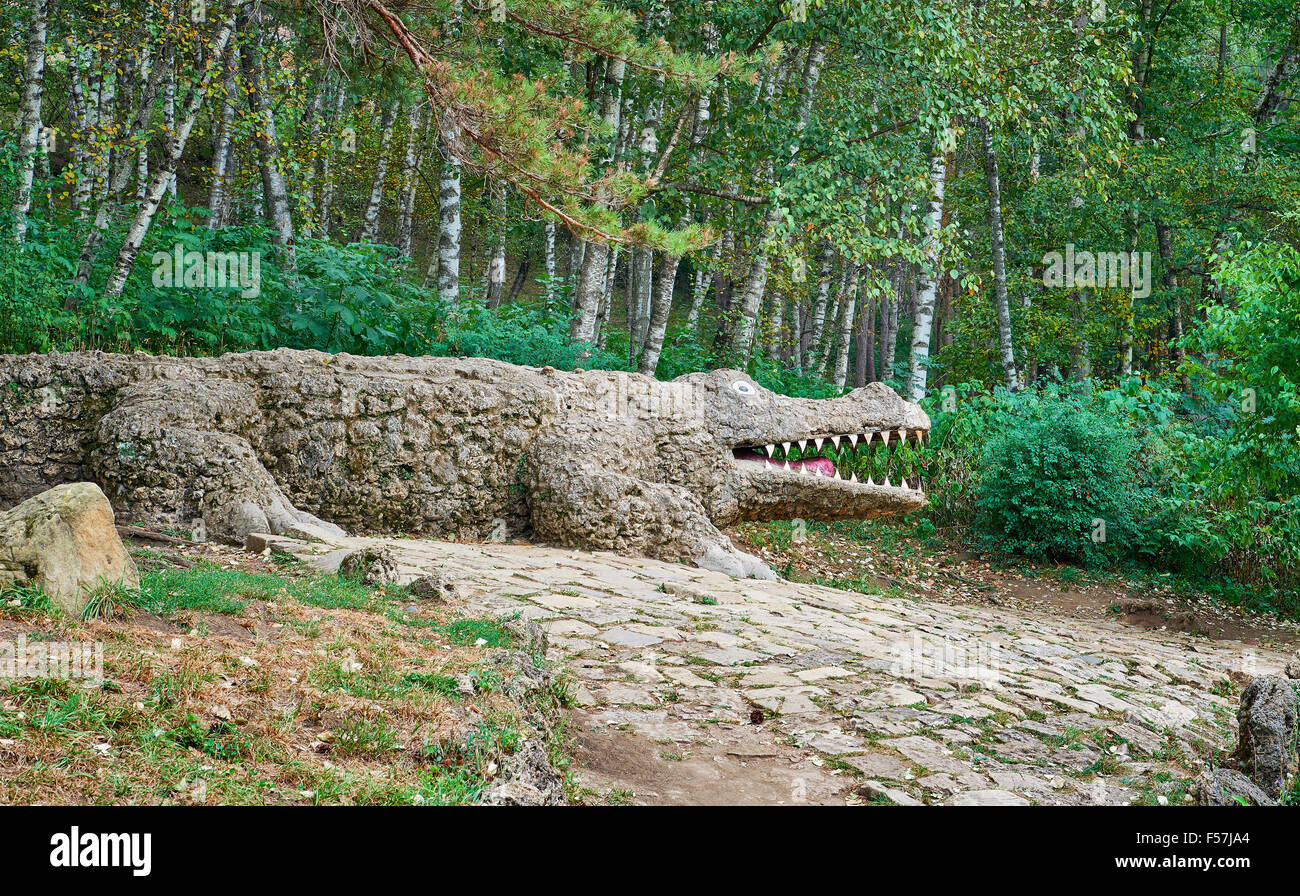 Stone Crocodile - Stock Image