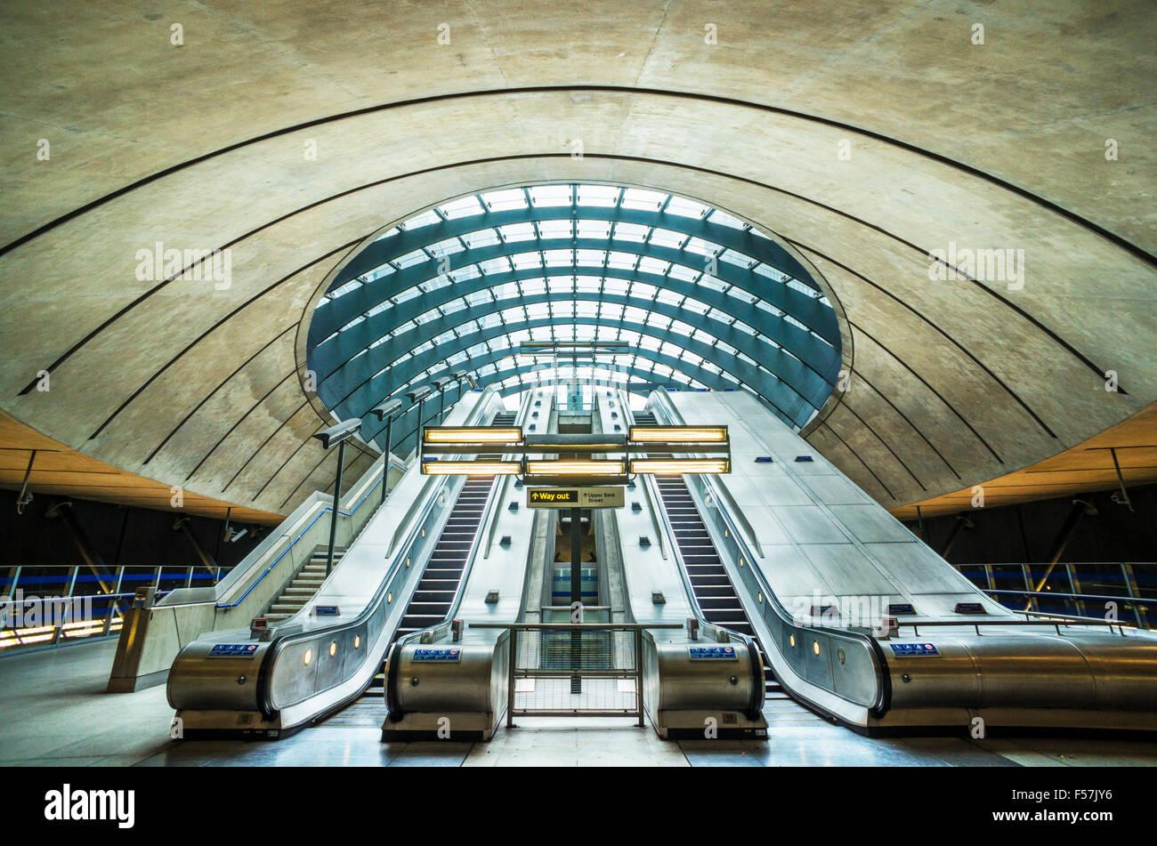Canary wharf underground station entrance with escalators London England UK Gb EU Europe - Stock Image