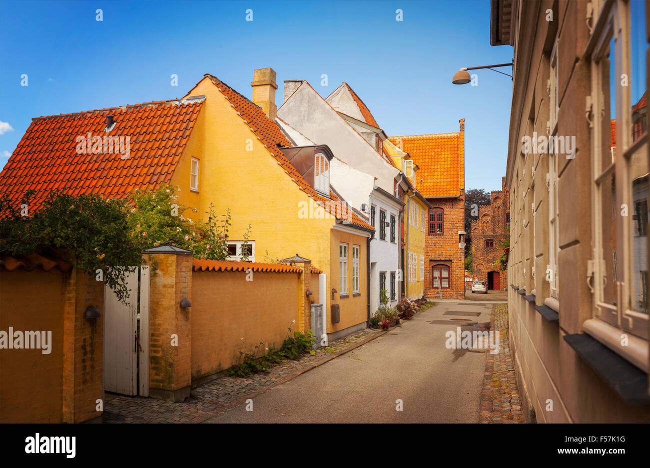 Image of a narrow residential street in the medieval town center of Helsingor, Denmark. - Stock Image